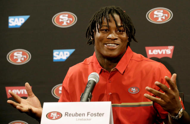 FILE - In this April 28, 2017, file photo, San Francisco 49ers draft pick Reuben Foster answers questions at a news conference in Santa Clara, Calif. Authorities say San Francisco 49ers linebacker Reuben Foster has been charged with felony domestic violence after being accused of attacking his girlfriend. The Santa Clara County District Attorney says Foster was charged Thursday, April 12, 2018, and is scheduled to be arraigned later in the day in San Jose. Prosecutors say the 24-year-old Foster attacked his girlfriend in February at their Los Gatos home, leaving her bruised and with a ruptured ear drum. (AP Photo/Jeff Chiu, File)