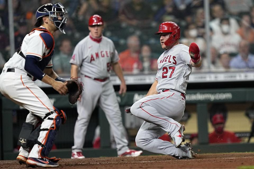 The Angels' Mike Trout scores as Houston Astros catcher Jason Castro waits for the throw.