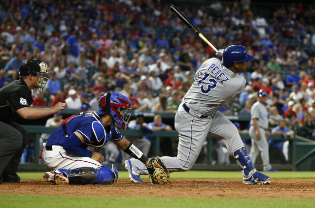 Kansas City Royals Salvador Perez (13) drives in two runs with a single against the Texas Rangers during the fifth inning of a baseball game Thursday, May 24, 2018, in Arlington, Texas. (AP Photo/Ron Jenkins)