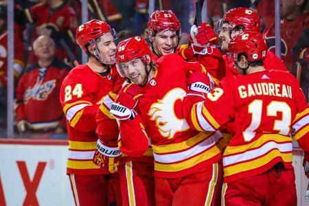 Nov 17, 2018; Calgary, Alberta, CAN; Calgary Flames center Elias Lindholm (28) celebrates with teammates after scoring a goal against the Edmonton Oilers during the third period at Scotiabank Saddledome. Mandatory Credit: Sergei Belski-USA TODAY Sports