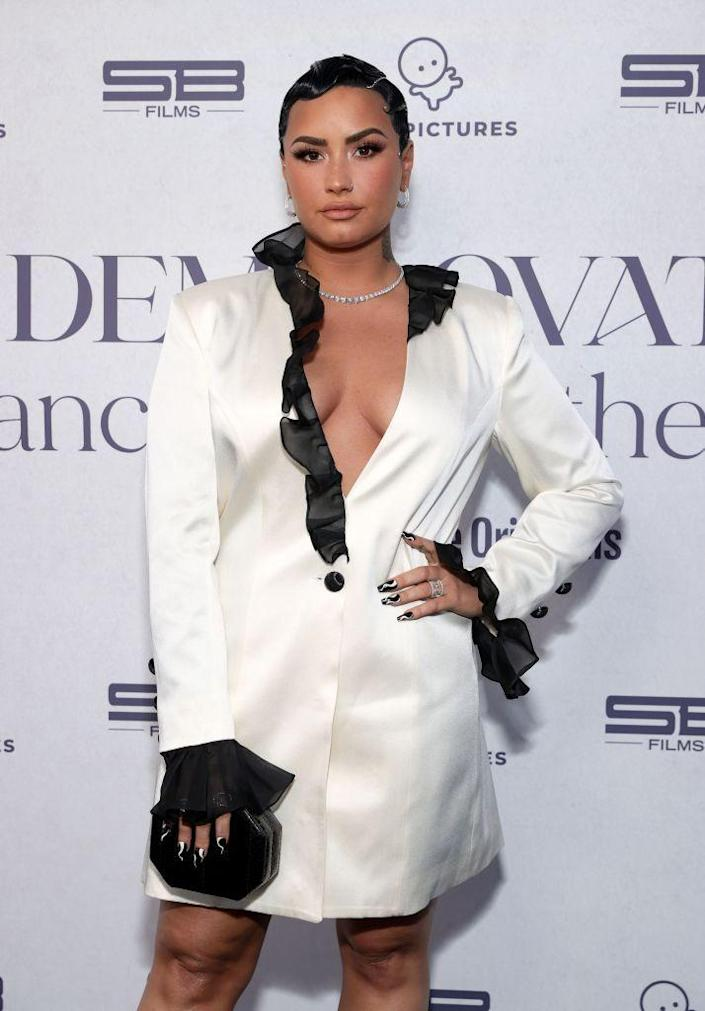 """<p>Demi shows off her Leo pride with a <a href=""""https://www.glamour.com/story/demi-lovato-lion-tattoo"""" rel=""""nofollow noopener"""" target=""""_blank"""" data-ylk=""""slk:lion tattoo on her hand"""" class=""""link rapid-noclick-resp"""">lion tattoo on her hand</a>.</p>"""