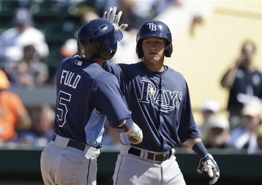 Tampa Bay Rays' Sam Fuld (5) is congratulated by teammate Jake Hager after hitting a two-run home run during the eighth inning of an exhibition spring training baseball game against the Detroit Tigers, Friday, March 29, 2013, in Lakeland, Fla. (AP Photo/Carlos Osorio)
