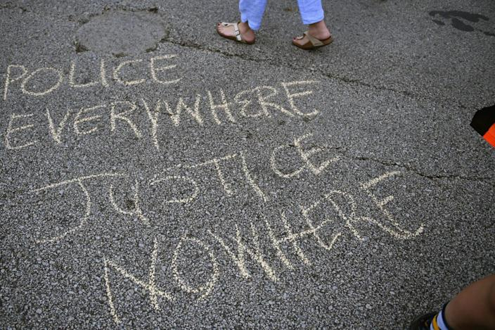 <p>Graffiti is written on the road as demonstrators march through downtown ahead of the Republican National Convention on July 17, 2016 in Cleveland, Ohio. (Photo: Jeff J Mitchell/Getty Images)</p>