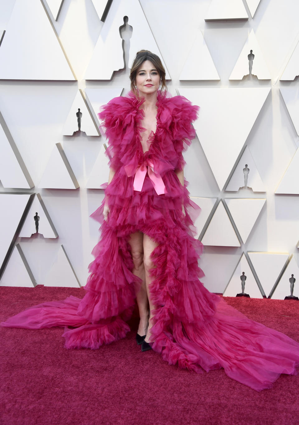 """<p>Cardellini's film """"Green Book"""" may have taken home the award for Best Picture in 2019, but the actress's ruffled fuchsia gown was an ill-fitting choice that garnered attention for all the wrong reasons.</p>"""