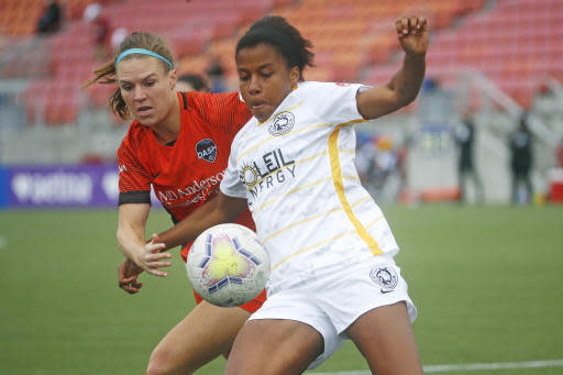 Utah Royals FC defender Elizabeth Ball, right, battles with Houston Dash forward Veronica Latsko for the ball during the first half of an NWSL Challenge Cup soccer match at Zions Bank Stadium Tuesday, June 30, 2020, in Herriman, Utah. (AP Photo/Rick Bowmer)