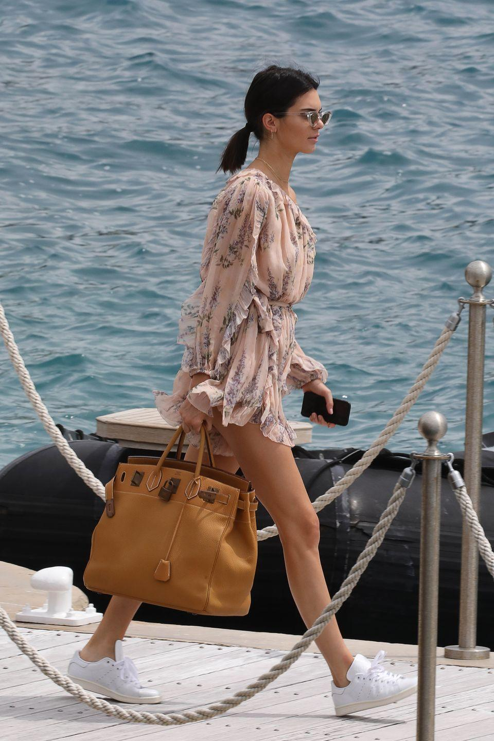 <p>An oversized doctor's bag and nude-coloured playsuit was the perfect French attire outfit during a day out in Cannes.</p>