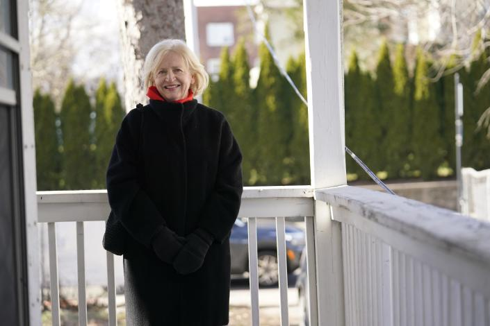 CEO of the Housing Development Fund, Joan Carty, poses for a portrait Tuesday, Dec. 29, 2020, in Stamford, Conn. With many New Yorkers moving to neighboring Connecticut during the pandemic, especially Fairfield County, it's becoming more challenging for people to find affordable homes to buy. Carty said the region's housing affordability issue is exacerbated by the influx. (AP Photo/Frank Franklin II)