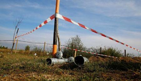 Ground anchors for a fence are seen at the Austrian-Hungarian border near Nickelsdorf, Austria, September 19, 2016. REUTERS/Leonhard Foeger