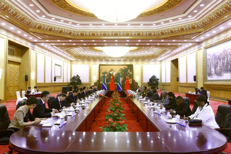 Chinese delegate led by President Hu Jintao, left, and South African counterpart led by President Jacob Zuma hold talks following a welcoming ceremony at the Great Hall of the People in Beijing Wednesday, July 18, 2012. Zuma is in Beijing to attend the opening ceremony of the fifth Ministerial Meeting of the Forum on China-Africa Cooperation (FOCAC) on Thursday. (AP Photo/Diego Azubel, Pool)