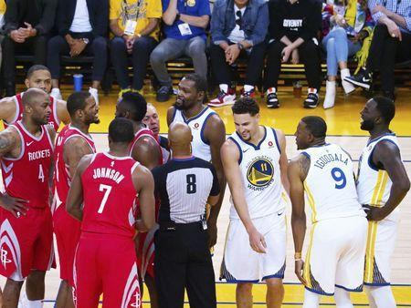 May 20, 2018; Oakland, CA, USA; The referees and teammates step in between Houston Rockets forward Trevor Ariza (1) and Golden State Warriors forward Draymond Green (23) after an altercation during the fourth quarter of game three of the Western conference finals of the 2018 NBA Playoffs at Oracle Arena. Mandatory Credit: Kelley L Cox-USA TODAY Sports