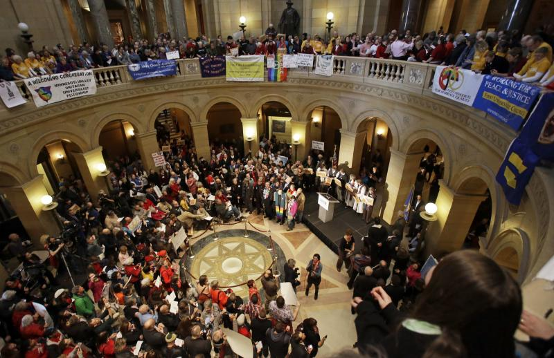 FILE - In this Feb. 14, 2013 file photo supporters of gay marriage gather to call for Minnesota lawmakers to legalize gay marriage at the State Capitol in St. Paul, Minn. Minnesota has a state House vote on gay marriage Thursday, May 9, 2013, and Democratic leaders are assuring passage. With the state Senate likely to follow suit, Democratic Gov. Mark Dayton could be signing a bill as early as next week. (AP Photo/Jim Mone, File)