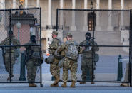 """National Guard troops keep watch at the Capitol in Washington, early Thursday, March 4, 2021, amid intelligence warnings that there is a """"possible plot"""" by a group of militia extremists to take control of the Capitol on March 4 to remove Democrats from power. The threat comes nearly two months after thousands of supporters of then-President Donald Trump stormed the Capitol in a violent insurrection as Congress was voting to certify Joe Biden's electoral win. (AP Photo/J. Scott Applewhite)"""