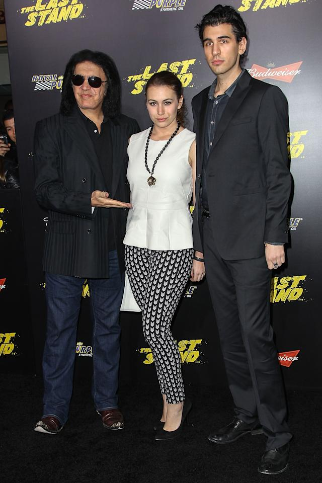 "HOLLYWOOD, CA - JANUARY 14:  (L-R) Recording artist Gene Simmons and children Sophie Simmons and Nick Simmons arrive at the premiere of Lionsgate Films' ""The Last Stand"" held at Grauman's Chinese Theatre on January 14, 2013 in Hollywood, California.  (Photo by Paul A. Hebert/Getty Images)"