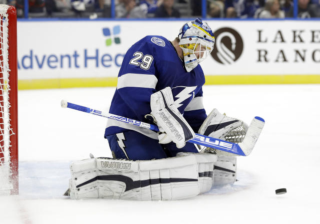 Tampa Bay Lightning goaltender Scott Wedgewood (29) makes a save on a shot by the Carolina Hurricanes during the third period of an NHL preseason hockey game Tuesday, Sept. 17, 2019, in Tampa, Fla. (AP Photo/Chris O'Meara)