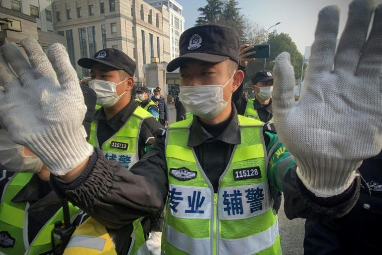Police attempted to stop journalists from recording footage outside the Shanghai Pudong New District People's Court on Monday