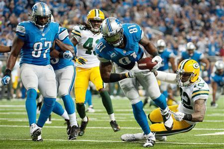Detroit Lions wide receiver Calvin Johnson (81) scores a touchdown during the third quarter against the Green Bay Packers during a NFL football game on Thanksgiving at Ford Field. Mandatory Credit: Tim Fuller-USA TODAY Sports