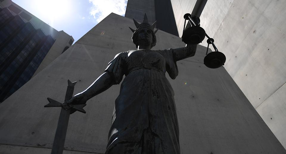 A statue of Themis, the Greek God of Justice stands outside the Supreme Court in Brisbane.