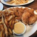 """<p>Cheddar's Scratch Kitchen is a haven of comfort food. The <a href=""""https://www.msn.com/en-us/foodanddrink/restaurantsandnews/these-are-the-most-popular-items-at-americas-biggest-chain-restaurants/ss-BBUvB6P#image=43"""" rel=""""nofollow noopener"""" target=""""_blank"""" data-ylk=""""slk:most comforting thing on the menu"""" class=""""link rapid-noclick-resp"""">most comforting thing on the menu</a>, according to customers, is the Chicken Tender Platter. These juicy boneless tenders come crispy and are available in classic, buffalo, or """"honey hot"""" sauces, and they're paired with fries. Not to mention, it's been your favorite since you were five. </p>"""