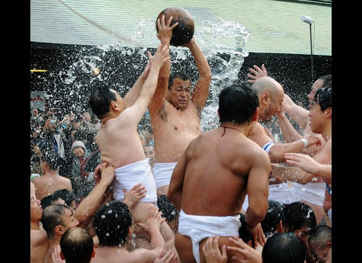 Naked men wearing only loincloths vie for a wooden treasure ball weighing eight kilos to bring good fortune, during the Tamaseseri festival at Hakozaki shrine in Fukuoka, on Japan's southern island of Kyushu on Jan. 3, 2012. Two teams of farmers and fishermen competed for the rich harvest or largest catch at a festival that dates back some 500 years.