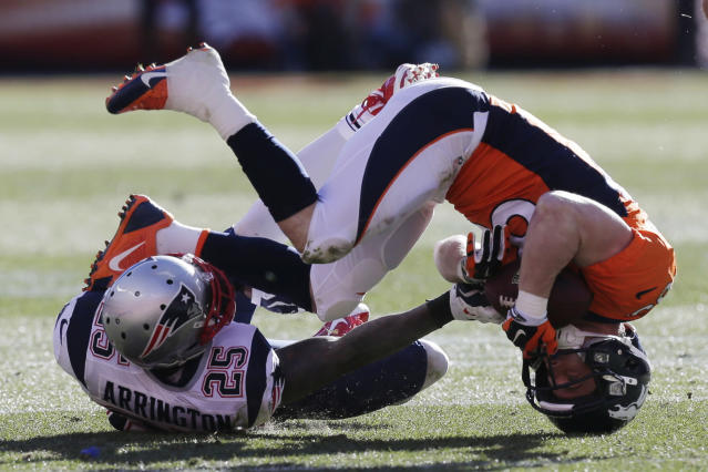 Denver Broncos wide receiver Wes Welker (83) is upended by New England Patriots cornerback Kyle Arrington (25) during the first half of the AFC Championship NFL playoff football game in Denver, Sunday, Jan. 19, 2014. (AP Photo/Julie Jacobson)