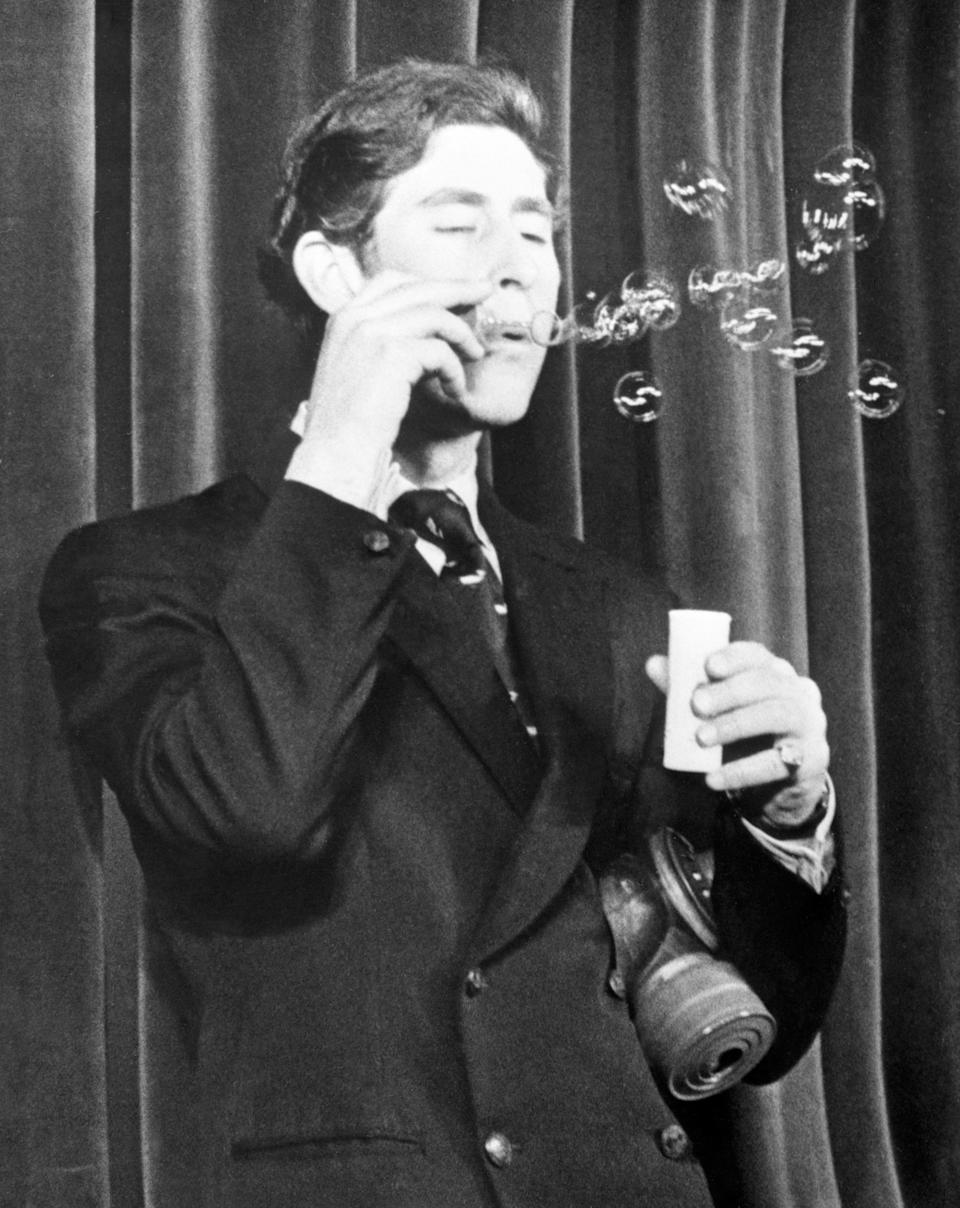 The Prince of Wales playing the role of a weatherman in a sketch during rehearsals for the Dryden Society's Trinity College revue in February 1970. (PA Images)