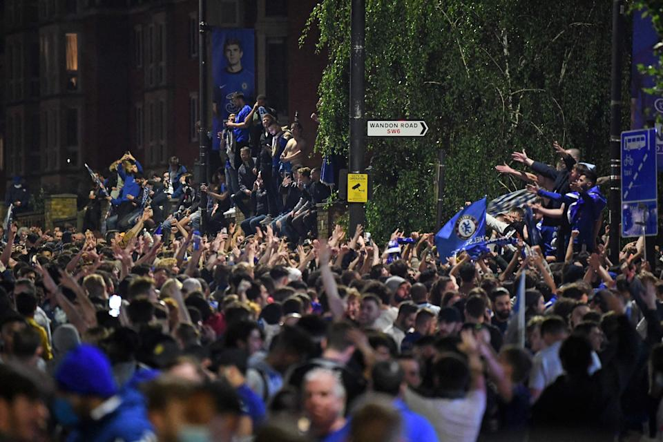 <p>Chelsea supporters celebrate in streets surrounding Chelsea's Stamford Bridge stadium</p> (AFP via Getty Images)