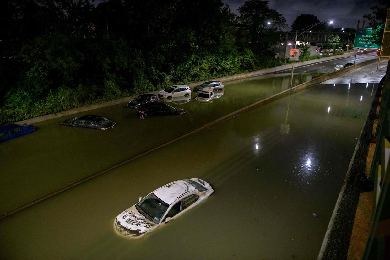 Floodwater surrounds vehicles following heavy rain on an expressway in Brooklyn, New York early on September 2.