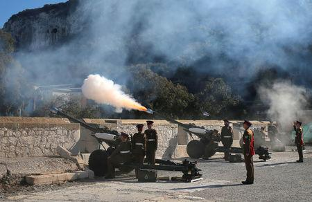Members of the Royal Gibraltar Regiment fire a 21-gun salute to mark the 67th anniversary of Britain's Queen Elizabeth's accession to the throne, in front of the Rock in the British overseas territory of Gibraltar, historically claimed by Spain February 6, 2019. REUTERS/Jon Nazca