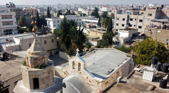 A picture taken with a drone shows the minaret of a mosque and the exterior of the Saint Porfirios church in Gaza City