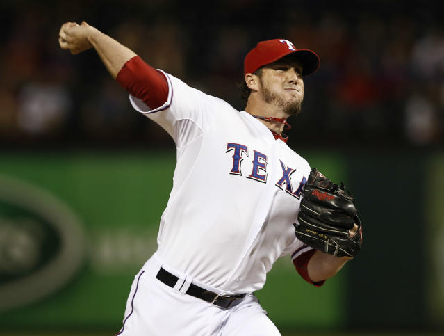 Texas Rangers relief pitcher Joe Nathan (36) delivers to the Los Angeles Angels during the ninth inning of a baseball game, Thursday, Sept. 26, 2013, in Arlington, Texas. The Rangers won 6-5. (AP Photo/Jim Cowsert)
