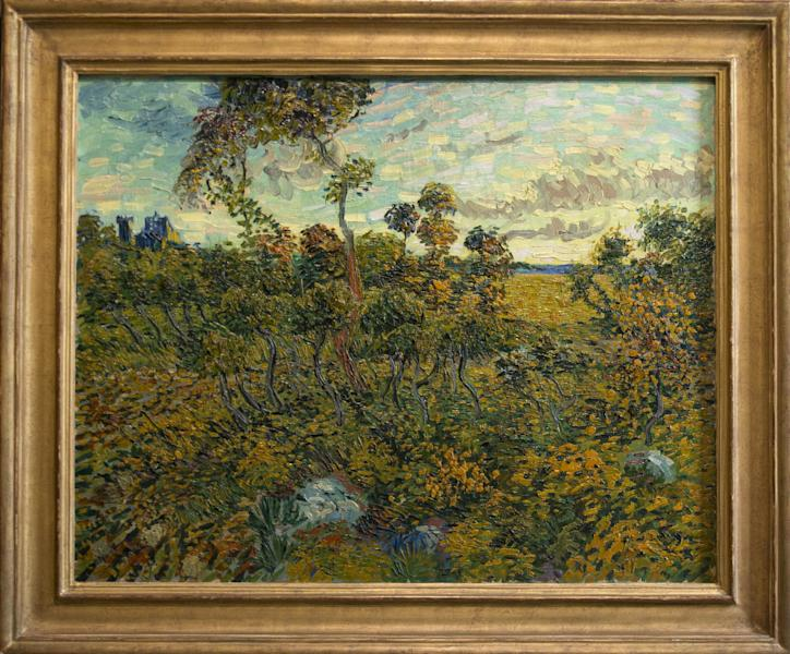 """Sunset at Montmajour"" by Dutch painter Vincent van Gogh is seen during a press conference at the Van Gogh Museum in Amsterdam, Netherlands, Monday Sept. 9, 2013. The museum has identified the long-lost painting which was painted by the Dutch mater in 1888, the discovery is the first full size canvas that has been found since 1928 and will be on display from Sept. 24. (AP Photo/Peter Dejong)"