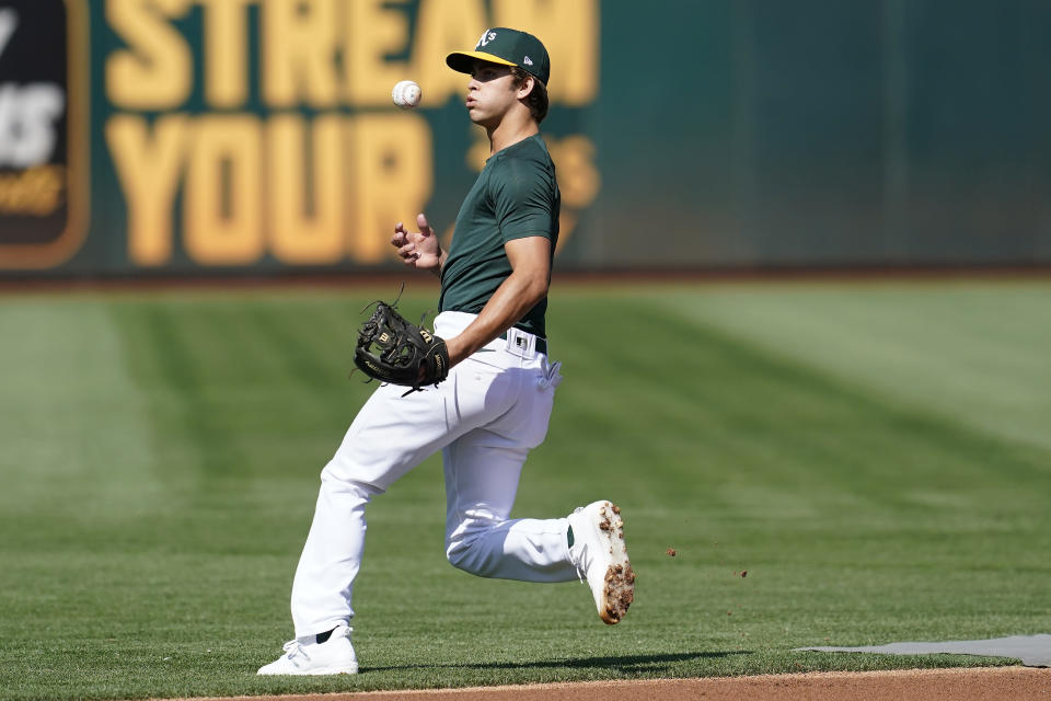 Oakland Athletics draft pick Max Muncy fields a ground ball during batting practice before a baseball game between the Athletics and the Los Angeles Angels in Oakland, Calif., Monday, July 19, 2021. (AP Photo/Jeff Chiu)