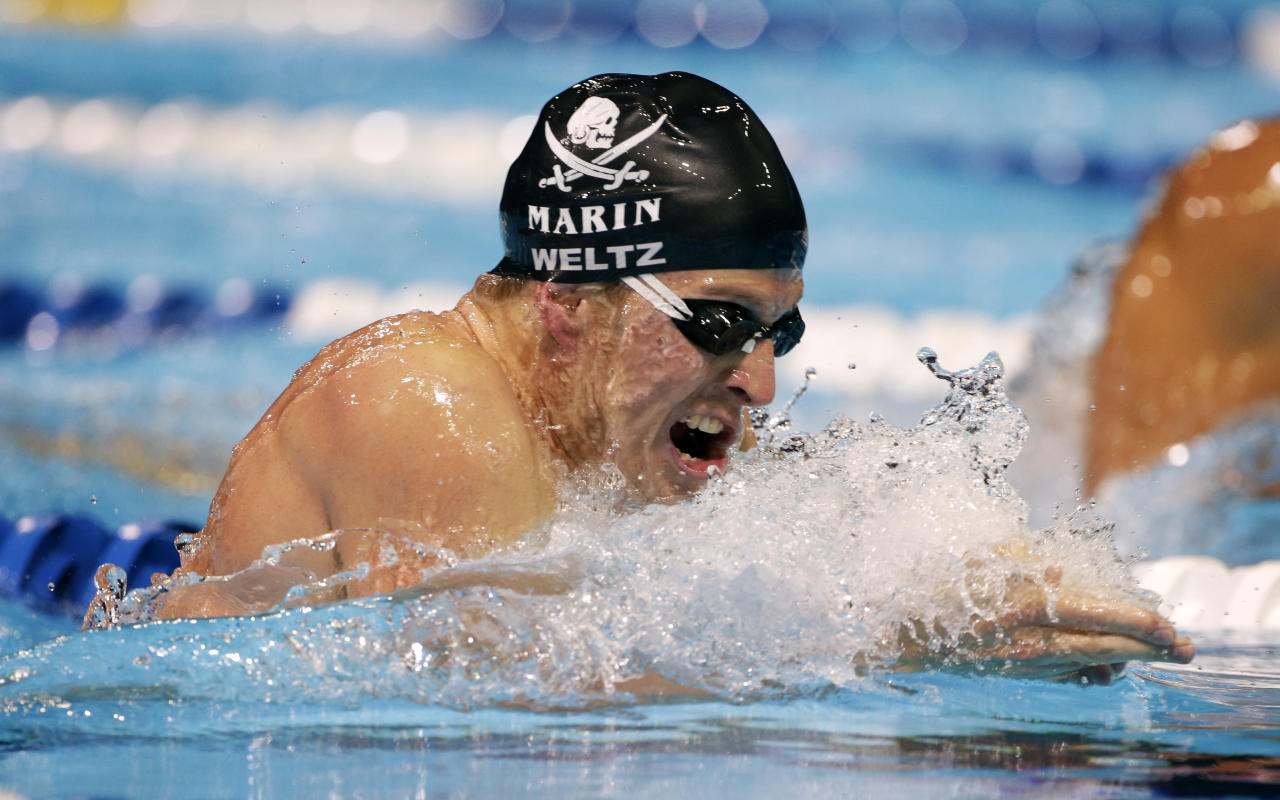 Scott Weltz swims to victory in the men's 200-meter breaststroke final at the U.S. Olympic swimming trials on Friday, June 29, 2012, in Omaha, Neb. (AP Photo/Mark Humphrey)