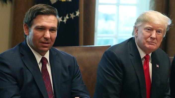 This December 2018 photo shows then-Florida Governor-elect Ron DeSantis (left) aside then-President Donald Trump (right) in the Cabinet Room at the White House. (Photo by Mark Wilson/Getty Images)
