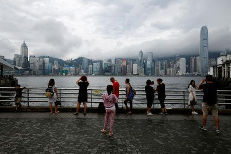 People gather at waterfront as Typhoon Roke approaches Hong Kong