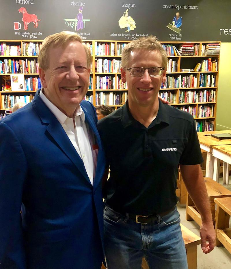 Carmel Mayor Jim Brainard, left, and Dave Schweikert pose together during roundabout trivia at Books & Brews Carmel in celebration of National Roundabout Week 2019.