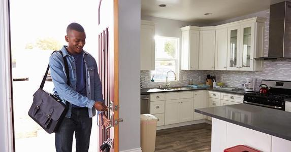 Man opening door to house after work | Monkey Business Images/Shutterstock.com