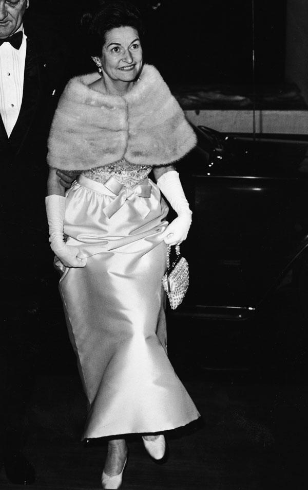 "<div class=""caption-credit""> Photo by: Getty Images</div><div class=""caption-title"">Lady Bird Johnson</div>Style Notes: A gown accessorized with white gloves is hard to pull off in a modern way, but topping your evening look with a luxe fur stole is forever a good idea. <br> <br> <b>Read More: <a href=""http://www.harpersbazaar.com/fashion/fashion-articles/mini-skirt-fashion?link=emb&dom=yah_life&src=syn&con=blog_blog_hbz&mag=har"" rel=""nofollow noopener"" target=""_blank"" data-ylk=""slk:The Most Iconic Mini Skirts of ALL TIME"" class=""link rapid-noclick-resp"">The Most Iconic Mini Skirts of ALL TIME</a></b>"