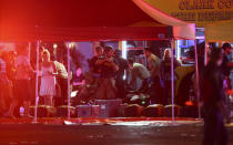 <p>Medics treat the wounded as Las Vegas police respond to the dramatic late-night shooting. (Chase Stevens/Las Vegas Review-Journal via AP) </p>