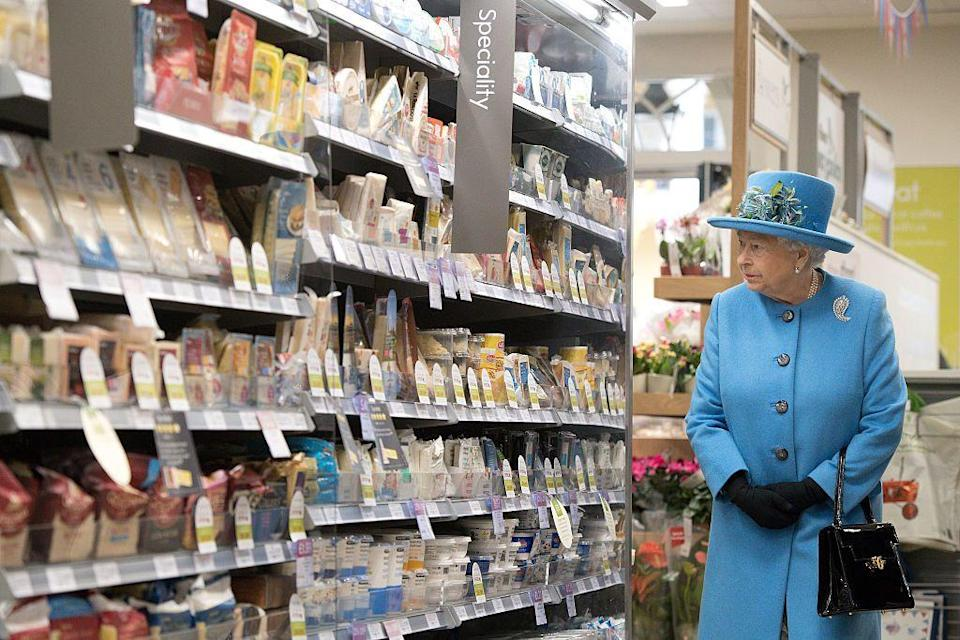 <p>The Queen wanders the aisles of a Waitrose grocery store in Poundbury. </p>