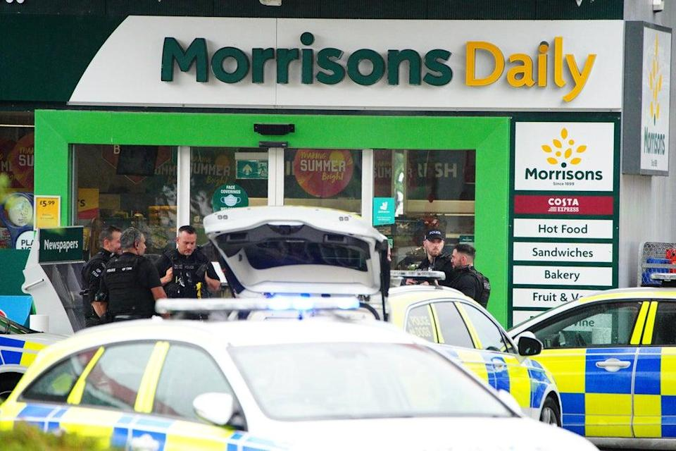 Armed police at the scene of an incident in Hengrove Way, Bristol, where a man armed with a knife is inside the shop of the petrol station. Staff members are uninjured within a safe room and in contact with officers. Picture date: Thursday September 9, 2021. (PA Wire)