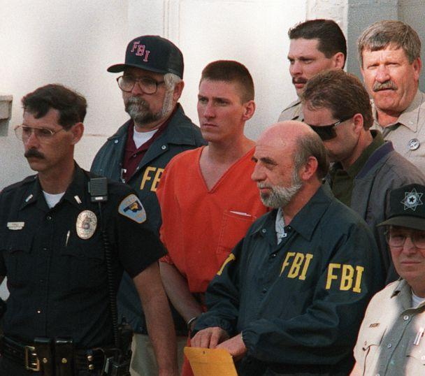 PHOTO: This April 21, 1995, file photo shows Timothy McVeigh being led by FBI agents after being charged with involvement in the April 19, 1995, bombing of the Alfred P. Murrah Federal Building in Oklahoma City, Okla. (Bob Daemmrich/AFP via Getty Images, FILE)