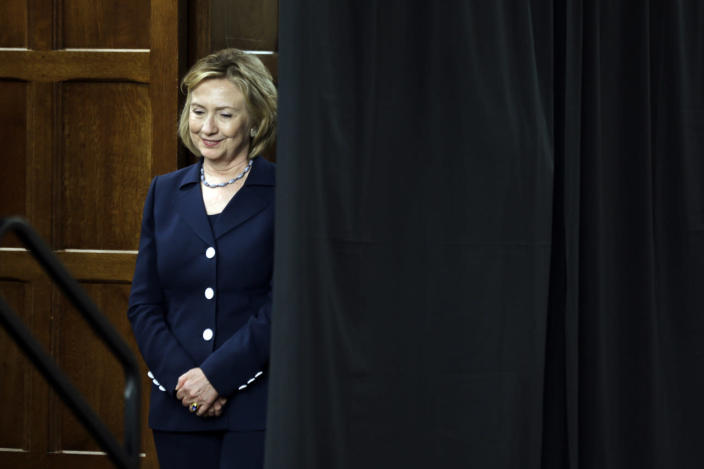 <p>Former Secretary of State Hillary Clinton waits to speak at a women's leadership symposium at Bryn Mawr College in Bryn Mawr, Pa., in July 2013. (Photo: Matt Rourke/AP)</p>