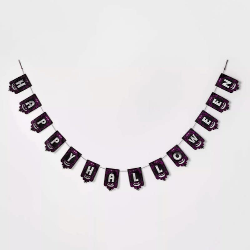 """<p>What's the 10-second trick to add festive flair to any room? Simply hang up this paper Halloween garland. With loops already attached on either end, all you'll need are two hooks or even push pins to secure it in place. Bonus points for adding matching black and purple balloons to the display. </p> <p><strong>To buy: </strong>Happy Halloween Paper Banner, $5, <a href=""""http://goto.target.com/c/249354/81938/2092?subId1=RS%2CTheBestHalloweenGarlandsUnder%252420%2Ckholdefehr1271%2CHOL%2CIMA%2C680012%2C201910%2CI&u=https%3A%2F%2Fwww.target.com%2Fp%2Fhappy-halloween-paper-banner-garland-black-purple-hyde-38-eek-boutique-8482%2F-%2FA-54390140"""" target=""""_blank"""">target.com</a>. </p>"""