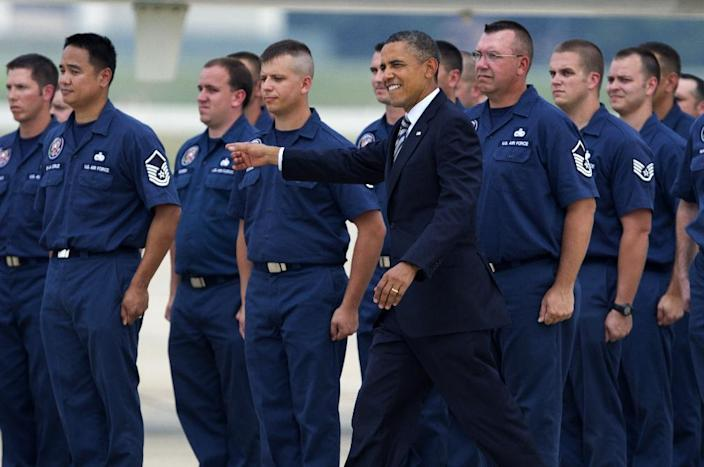 President Barack Obama greets members of the Presidential Logistics Squadron who maintains Air Force One fleet, during a ceremony presenting one of it's planes after a year-long depot level maintenance, Monday, Aug. 6, 2012, at Andrews Air Force Base, Md., before departing for a campaign trip to Stamford, Conn. (AP Photo/Manuel Balce Ceneta)