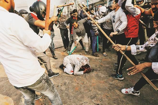 A group of men beat Mohammad Zubair during violent clashes in the national capital last month (Reuters image)