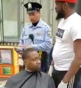 Man giving homeless haircuts nearly gets shut down by police. (Photo: Twitter)