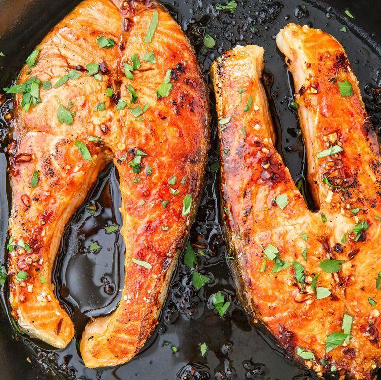 """<p>You can pan fry, bake, or grill salmon steaks. We love pan-frying them because they take only 10 minutes to cook.</p><p>Get the <a href=""""https://www.delish.com/uk/cooking/recipes/a30192566/salmon-steak-recipe/"""" rel=""""nofollow noopener"""" target=""""_blank"""" data-ylk=""""slk:Salmon Steaks"""" class=""""link rapid-noclick-resp"""">Salmon Steaks</a> recipe.</p>"""