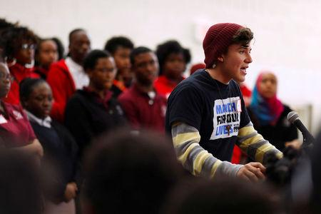 FILE PHOTO: Alfonso Calderon, a junior from Marjory Stoneman Douglas High School, speaks during a rally with Thurgood Marshall Academy students in advance of Saturday's March for Our Lives event in Washington, U.S. March 22, 2018. REUTERS/Eric Thayer