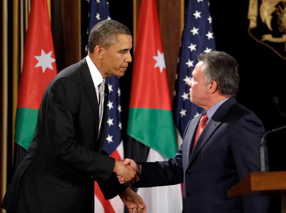 In this March 22, 2013, file photo, President Barack Obama, left, and Jordan's King Abdullah II shake hands following their joint new conference at the King's Palace in Amman, Jordan.